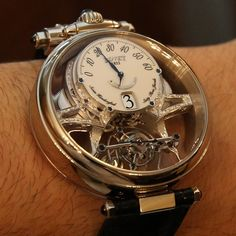 Bovet Virtuoso, tourbillon 5 day power reserve with jumping hours & retrograde minutes. Hand engraved, double sided case with two dials & large domed crystals.