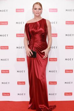 Celebrity Fashion: Uma Thurman wearing a thigh high slit; ruche; off the shoulder red custom made Versace gown at the Moet & Chandon and FilmAid Asia Power of Film Gala at Clear Water Bay Film Studios on March 16, 2013 in Hong Kong, Hong Kong.
