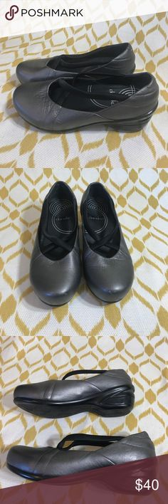 Dansko silver clogs with criss cross straps 36 6 Women's dansko silver clogs size euro 36 US 6. Clogs have a criss cross black straps across the top of the foot, good used condition- a few wear marks but overall lots of life left! Bottoms are like new! Dansko Shoes Mules & Clogs