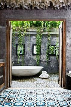 Concrete and timber, a dramatic pop of pattern, pebbles and plants cascading down the walls. Beautiful outdoor bathroom!