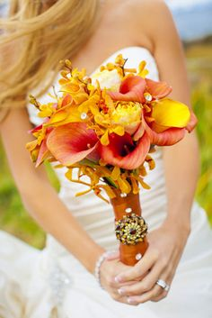 Full view of Tara's stunning fall bridal bouquet.  These colors are perfect for her ornate venue and October wedding.  The tall calla lillies add a touch of elegance to this whimsical bunch.  Photos by Clane Gessel Photography | #weddings #photography #bridal #flowers #fallweddings