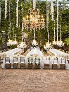 The possibilities are endless when it comes to setting up your outdoor reception. Decorate the space with low-hanging chandeliers and delicate florals. Instead of round tables, seat everyone banquet style for a close and intimate atmosphere.