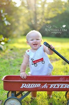 Red wagon themed photo shoot. First birthday theme. Radio flyer. Baby boy.