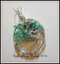 Tree of Life pendant with a handmade lampwork cab in one corner and turquoise crystal bicones