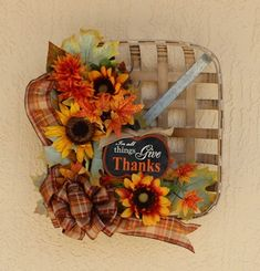 This lovely tobacco basket has an array of beautiful sunflowers accented with a hand made bow. This one of a kind arrangement can brighten up any room. The basket measures x x tall. Basket Flower Arrangements, Floral Arrangements, Thanksgiving Decorations, Fall Decorations, Thanksgiving Ideas, Halloween Decorations, Tobacco Basket Decor, Dollar Tree Fall, Fall Wreaths