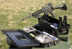 The MTM Tactical Range Box is an all-in-one solution for AR shooters, it also works with other semi-auto rifles, bolt-action rifles and shotguns as well. It contains plenty of storage space for cleaning kits, ammo or mags. It has a removable top storage box as well as a cleaning-station base. It also has two adjustable gun forks to hold your rifle as well as an action block insert arm to fit the AR-15/M16 magwell during maintenance. - See more at…