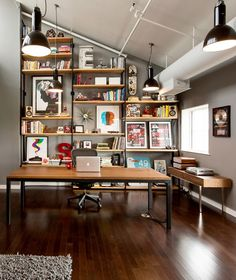 I would love coming into this as my office space....I'd probably sit & stare at the shelves!