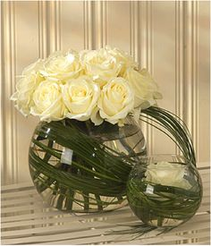 Google Image Result for http://www.tiger-lily.net/ekmps/shops/tigerlily/images/a-stunning-arrangement-of-roses-displayed-in-a-glass-vase-linked-to-a-second-smaller-vase-140-p.png