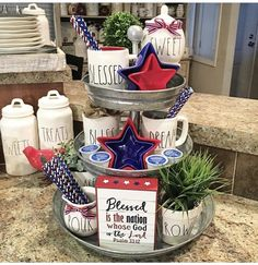 Decor On A Patriotic Farmhouse Tiered Tray Today we are going to honor Old Glory as it plays a big part in decor on a patriotic farmhouse tiered tray. Get ready for a little Red, White & Blue pride! Fourth Of July Decor, 4th Of July Decorations, 4th Of July Party, House Decorations, July 4th, Home Design, Logo Instagram, Succulent Centerpieces, Centerpiece Ideas