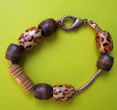 """Antiqued copper snake chain with wooden beads, """"Safari Bracelet"""".  $14.00.  Cool."""