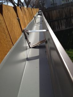 Growing strawberries (Or any plants!) from a gutter hung on the fence @ Pin For Your Home