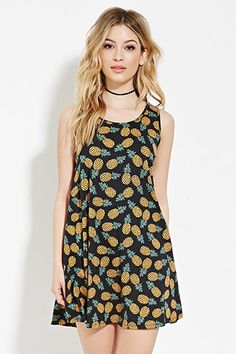 Pineapple Print Mini Dress Style Deals - A knit mini dress with a sleeveless cut, a round neckline, and an allover pineapple print...