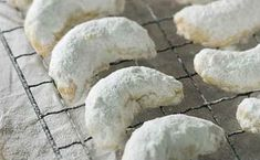 Yiayia's Kourabiethes (Grandma's Greek shortbread). These delicious buttery biscuits contain a hint of vanilla and ouzo and are the perfect way to celebrate Greek Easter! Smothered in mounds of white icing sugar they are the perfect afternoon treat. Greek Cake, Greek Cookies, Easter Biscuits, Greek Easter, Buttery Biscuits, Shortbread Recipes, Lebanese Recipes, Sweet Pastries, Easter Cookies