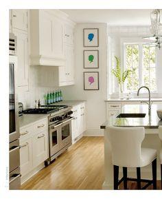 White modern kitchen + pops of color via Interiors Magazine #creativekitchen