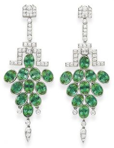 A PAIR OF GREEN TOURMALINE AND DIAMOND EAR PENDANTS, BY TIFFANY & CO.   Each suspending a tapered cluster of collet-set oval-cut green tourmalines, enhanced by three collet-set diamonds and a pear-shaped drop set with diamonds, from an openwork square and circular-cut diamond link and surmount of geometric design, mounted in platinum, in a Tiffany & Co. black suede case  Signed Tiffany & Co., no. 18453886