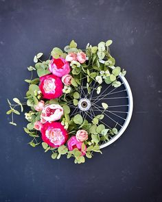 Pretty in pink! A vintage bike wheel topped with heart-stopping bright fuchsia peonies! All bike wreaths are made by hand, one at a time, making each wheel and wreath unique. All florals used are artificial. Wreath Crafts, Diy Wreath, Door Wreaths, Diy Crafts, Bicycle Rims, Bicycle Wheel, Bike Wheels, Flower Cart, Pink Peonies