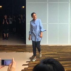 Long blue shirt. Grey pants. Snakeskin skaters.