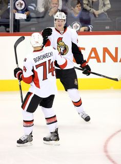 CrowdCam Hot Shot: Ottawa Senators Buddy Robinson is congratulated after scoring by defenceman Mark Borowiecki during the first period against the Winnipeg Jets at MTS Centre. Photo by Bruce Fedyck