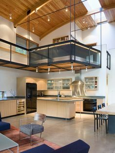 Modern Kitchen Design | Balance Associates Architects | Wood panel ceiling, catwalk over kitchen, loft over kitchen, mezzanine, open concept.
