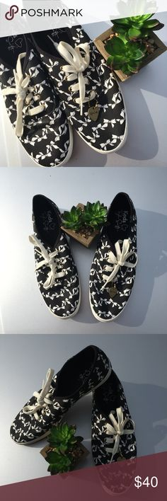 Taylor Swift printed Keds size 8.5 Adorable Taylor Swift Keds! Size 8.5 Black shoes, printed with white bows Cute (removable) heart attached at front Good gently used condition! Worn twice! Some marker writing on bottom Keds Shoes Sneakers