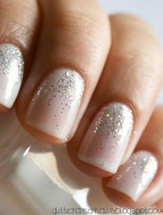 Nude polish with silver glitter cuticles.
