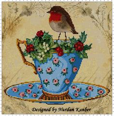 """""""Robin on the Christmas Cup"""" designed by Nurdan Kanber"""