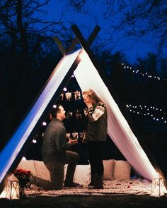 This tent takes backyard proposals to a new level. So romantic, creative, and personal!