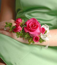 Expressing elegance in a soft feminine tone, the corsage features a standard sized pink rose bloom accompanied by a quartet of petite pink s...