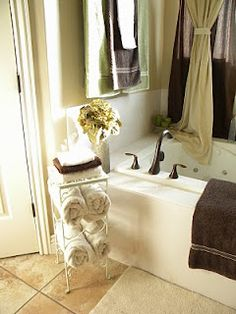 Wine rack towel holder - love it much.  Random containers can be fun in organizing various rooms of your house.  I always like a small chair in the bathroom, comes in handy and handy is good.  #organizing_for_tranquility_and_creativity