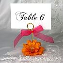 DIY table number holders! Great idea since these things are SO expensive.