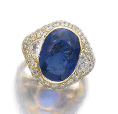 SAPPHIRE AND DIAMOND RING, BULGARI, 1960S. Set with an oval sapphire, trilliant and brilliant-cut diamonds, size 52, signed Bulgari