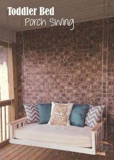 A refurbished toddler bed or crib is the perfect oversized porch swing for everyone to enjoy! Check out our DIY toddler bed porch swing here. by bridgette.jons
