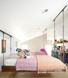Ree Drummond—also known as The Pioneer Woman—transformed her family's attic into a bedroom for her daughters in a style that's a little bit country, a little bit rock 'n' roll. She bypassed typical tween motifs in favor of sophisticated separates, including crisp white sheets and blankets in fresh cranberry and tangerine hues. Quirky throw pillows pile on extra charm. See the complete makeover »