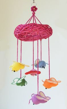 Crochet baby mobile with butterflies and flower
