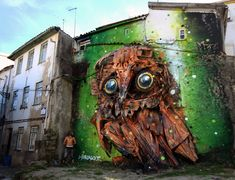 Artist Bordalo II has, once again, brought garbage alive into this wonderful, colorful street art in Lisbon. Check out his other creations via https://dennisboots.wordpress.com/2014/11/26/fascinerendefoto-vuilnis-komt-tot-leven-2/