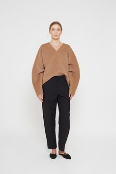<p>Rennes is a voluminous sweater, crafted from a luxurious camel colored, cashmere blend. This style features a V-neck cut, and a decorative seam cutting vertically through the front. The sleeves have a slightly round shape - creating a beautiful silhouette. Wear with your Original denims, or the Novara trousers for a chic everyday look.</p>
