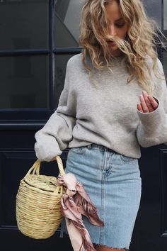 A jean skirt and a touch of pink.
