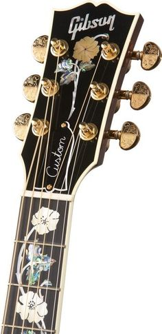Gibson electric Custom Quilted Maple with Vine Inlay Acoustic Guitar Sunburst, looks like it as well as fretboard is decorated with abalone shell colorful engravings.