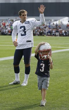 Patriots kicker Stephen Gostkowski with his son (Photo by Stew Milne, USA TODAY Sports)