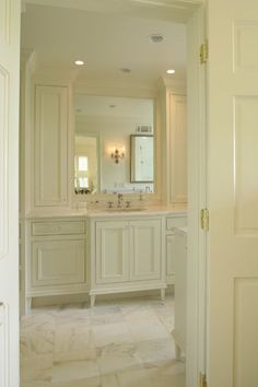 Love the feel of this room---clean and cozy/lighting---Jeff may prefer darker cabinetry but like the mood created---traditional bathroom by Structures, Inc.