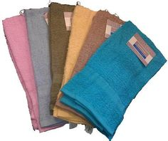 """Solid Terry Hand Towel Measures: 16"""" x 26"""" 100% terry cotton. Assorted colors 10 single ringspun. 2.5 oz."""