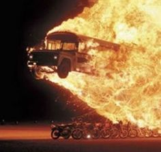 DareDevil Stunt. Flaming Bus over motorcycles!