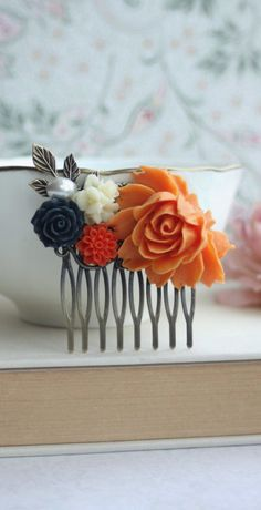 Orange and Navy Blue Wedding. Orange Rose Flower, Navy Blue, Ivory Flowers, Pearl Antiqued Brass Hair Comb. Orange and Blue Wedding Bridesmaid Gifts by Marolsha. Wedding inspiration and ideas here: www.weddingideastips.com