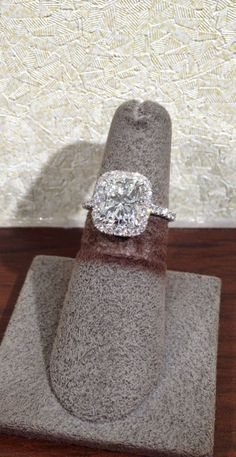 Elongated cushion cut, thin halo, thin diamond band--still a big fan of the elongated cushion but would want it to be more rectangular and less square. Obsessed