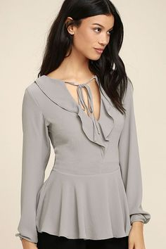 Lulus Exclusive! Timeless and totally on-trend, the Sugar Sweet Grey Long Sleeve Peplum Top is an instant favorite! Lightly textured, lightweight woven fabric ruffles along a tying neckline, and falls to long sleeves with button cuffs. Flirty peplum tier. Hidden back zipper/clasp.