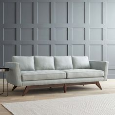 Fusing together a mid century feel with a modern day twist, the Cosgrove sofa is a gorgeous neutral focal point for any living space. Upholstered and button tufted, this piece is timeless and encompasses modern elegance.