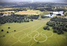 In this handout image released by LOCOG on July 9, 2012, an aerial view of Olympic Rings cut into the grass of Richmond Park, London, England. The rings, which are approximately 300 metres wide and over 135 metres tall, are visible on the Heathrow flight path, ready to welcome athletes and visitors to the London 2012 Olympic Games.