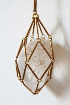 Crystal cage necklace. Combines two of my favorite jewelry trends—polygonal open shapes and raw crystals.