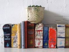 Literature Heavyweights. Old bricks painted to look like classic books by Daryl Fitzgerald. Via smithjournal blog