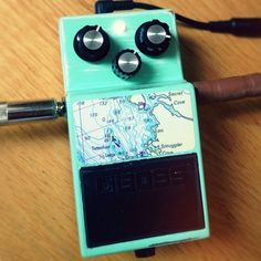 This is an @ibanez_USA Tube Screamer inside the casing of a @Roland_US BOSS DS-1, custom painted vintage seafoam green/white and decorated with a with a BC nautical chart.